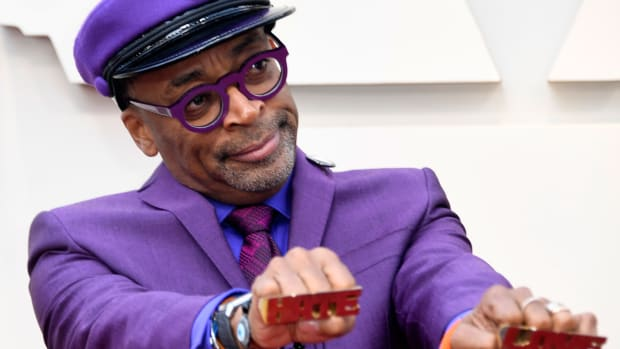 "Spike Lee, director of BlacKkKlansman, attends the 91st Annual Academy Awards on February 24th, 2019, wearing the ""Love"" and ""Hate"" rings from his 1990 film, Do the Right Thing."