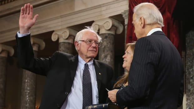 Joe Biden swears in Senator Bernie Sanders (I-Vermont).