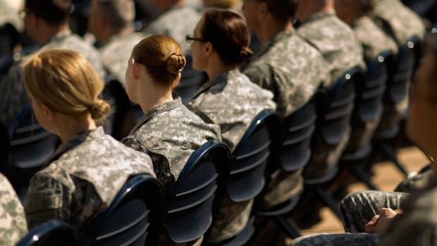 Soldiers, officers and civilian employees attend the commencement ceremony for the U.S. Army's annual observance of Sexual Assault Awareness and Prevention Month in the Pentagon Center Courtyard on March 31st, 2015, in Arlington, Virginia.