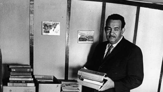 Civil rights activist Reverend Francis Griffin holds school books donated for the private schooling of black children, circa 1959. Prince Edward County shut down its public school system to avoid having to desegregate. (Horizontal)
