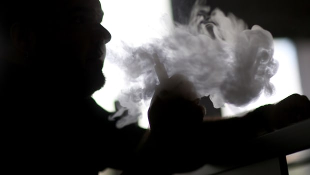 Michael Crespo enjoys an electronic cigarette at the Vapor Shark store on February 20, 2014 in Miami, Florida.
