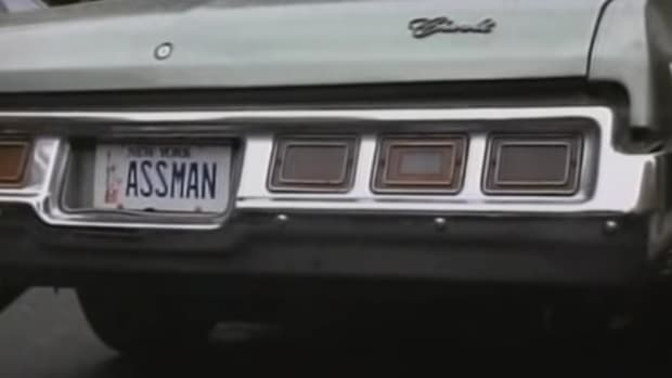 "A vanity license plate reading ""ASSMAN"""