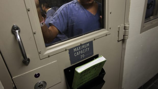 An immigrant stands in a holding cell at the U.S. Immigration and Customs Enforcement detention facility for illegal immigrants on July 30th, 2010, in Florence, Arizona.