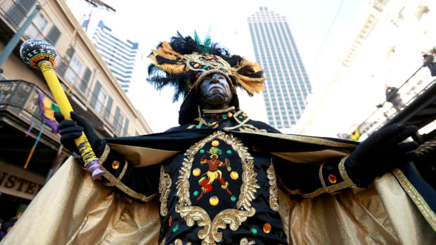 A member of the Zulu Social Aid and Pleasure Club marches down St. Charles Avenue during a Mardi Gras parade on March 5th, 2019, in New Orleans, Louisiana. Mardi Gras, also called Shrove Tuesday, Carnival Tuesday, or Pancake Day, is associated with Carnival celebrations in New Orleans, Rio de Janeiro, and around the world.