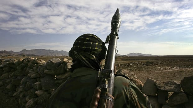 An Afghan National Army soldier looks toward the Pakistani border only 200 meters away.