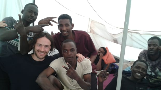 Refugees in the Calais Jungle pose with one of Pearce's friends during a 2016 visit.