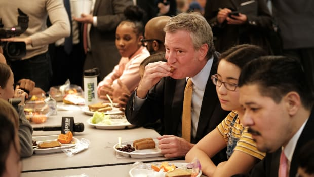 New York Mayor Bill de Blasio joins Schools Chancellor Richard Carranza and school children for lunch at P.S. 130, a Brooklyn public school, for an announcement about Meatless Mondays on March 11th, 2019, in New York City.