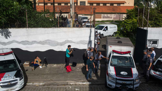 Funeral cars carrying bodies leave the public school where two former students opened fire on March 13th, 2019, in Suzano, Brazil. The gunmen killed at least 10 people and injured more than 20 others before killing themselves.