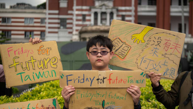 Yang Tzy-Ching, 12, a sixth grade student, takes part in the Global Climate Strike to protest climate change and government inaction in front of the Presidential Palace on March 15th, 2019, in Taipei, Taiwan.