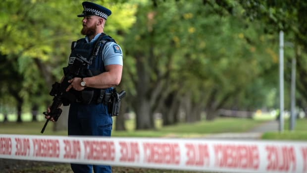 A police officer carrying an automatic rifle guards the area near Al Noor mosque on March 17th, 2019, in Christchurch, New Zealand.