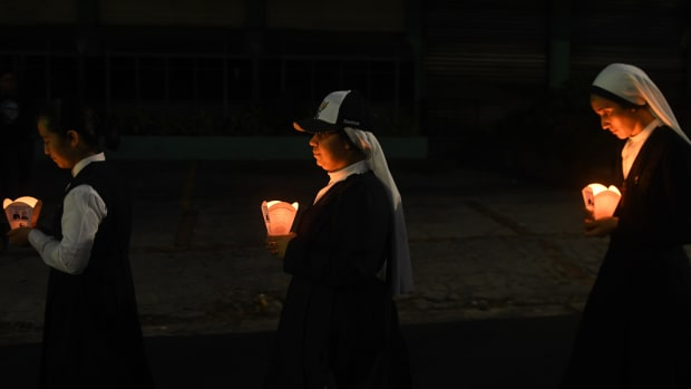 Young Catholic faithfuls take part in vigil commemorating the 38th anniversary of the assassination of Salvadorean Archbishop Oscar Arnulfo Romero.