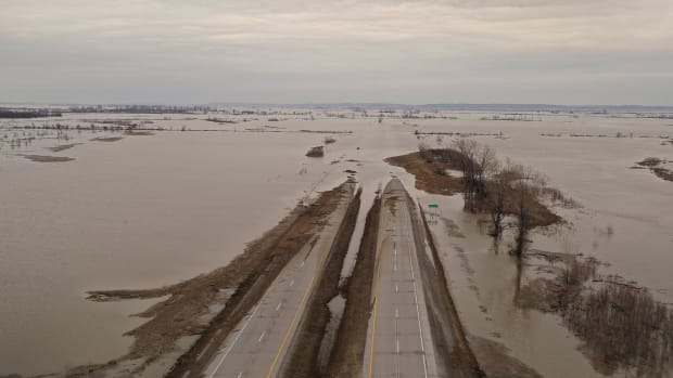 Following a bomb cyclone that dumped rain and melted snow across the Midwest, many sates—Iowa, Missouri, and Nebraska, especially—have experienced flooding. Pictured here, floodwater covers Highway 2 on March 23rd, 2019, near Sidney, Iowa.
