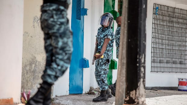 Comoros gendarmerie officers disperse opposition supporters in the city of Moroni on March 25th, 2019. Police fired tear gas and rubber bullets on a crowd of more than 100 as Comoros awaited results of its election, which Agence France-Presse journalists said President Azali Assoumani is expected to win, despite the opposition's accusations of cheating.