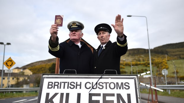 Border Communities Against Brexit protesters pose as customs officers at a rally along the border between the Republic of Ireland and the United Kingdom on March 30th, 2019, in Newry, Ireland.