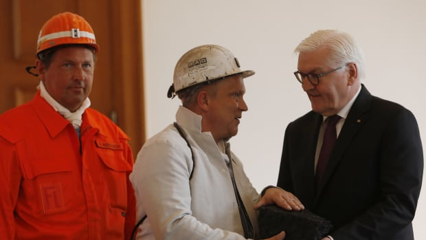 Coal miners give German President Frank-Walter Steinmeier a symbolic final chunk of coal in a ceremony at Schloss Bellevue presidential palace on April 3rd, 2019, in Berlin, Germany. Germany's last underground coal mine, located in the Ruhr region, closed in December. However, Germany still mines large amounts of lignite coal from open cast mines near Cologne and in eastern Germany.