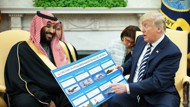 President Donald Trump looks at a defense sales chart with Saudi Arabia's Crown Prince Mohammed bin Salman in the Oval Office of the White House on March 20th, 2018.
