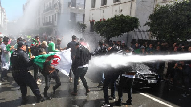 Algerian security forces use a water canon to disperse students taking part in an anti-government demonstration in the capital city of Algiers on April 9th, 2019. Lawmakers named the speaker of the upper house as Algeria's first new president in two decades on Wednesday, after the resignation of Abdelaziz Bouteflika following mass protests.
