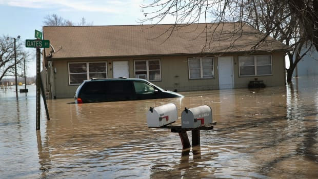 An apartment building is surrounded by floodwater on March 22nd, 2019, in Craig, Missouri.
