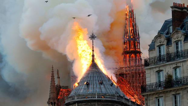 Smoke and flames rise during a fire at the landmark Notre Dame Cathedral in central Paris on April 15th, 2019. The fire may have involved renovation work being carried out at the site, the fire service said.