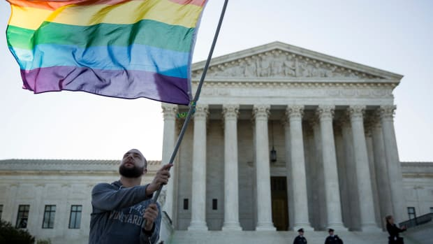 A same-sex marriage supporter waves a rainbow pride flag near the Supreme Court, on April 28th, 2015, in Washington, D.C., just days before the Supreme Court heard arguments on same-sex marriage.