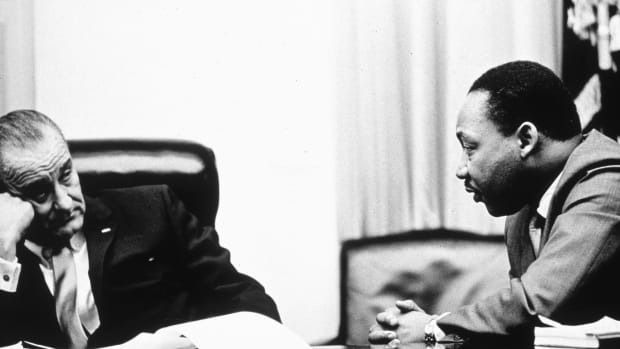 President Lyndon B Johnson discusses the Voting Rights Act with Martin Luther King Jr. at the White House in 1965.
