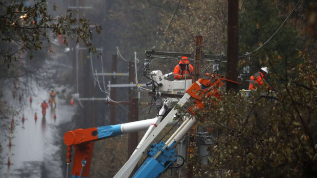 PG&E crews repair power lines that were destroyed by the Camp Fire on November 21st, 2018, in Paradise, California.