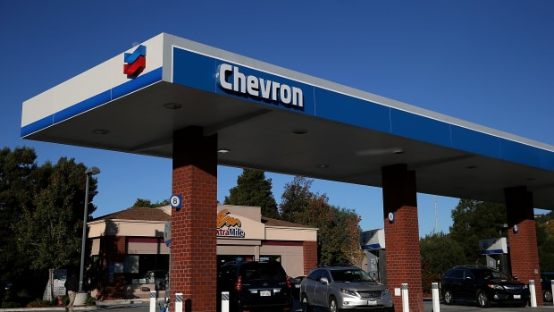 The Chevron logo is displayed at a Chevron station in Greenbrae, California.