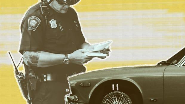 A cop writes a parking ticket