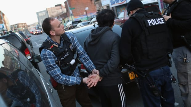 U.S. Immigration and Customs Enforcement officers arrest an undocumented Mexican immigrant during a raid in Bushwick, Brooklyn, in April of 2018.