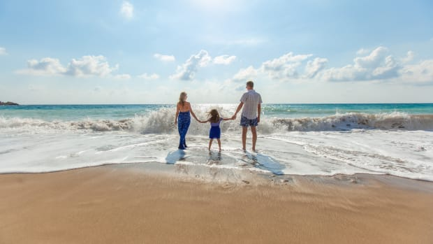 family child parents beach climate change