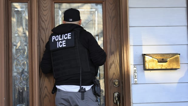"Immigration and Customs Enforcement officers arrive at a home in search of an undocumented immigrant on April 11th, 2018, in New York City. New York is considered a ""sanctuary city"" for undocumented immigrants, and ICE receives little or no cooperation from local law enforcement."
