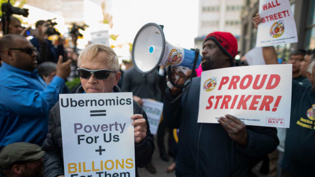 Drivers take part in a rally demanding more job security and livable incomes, at Uber and Lyft's New York City headquarters on May 8th, 2019. Rideshare drivers in major United States cities were set to stage a series of strikes and protests Wednesday, casting a shadow over the keenly anticipated Wall Street debut of sector leader Uber. Drivers for Uber, Lyft, Via, and other platforms are seeking improved job security, including an end to arbitrary deactivations, and a better revenue split between drivers and platforms.