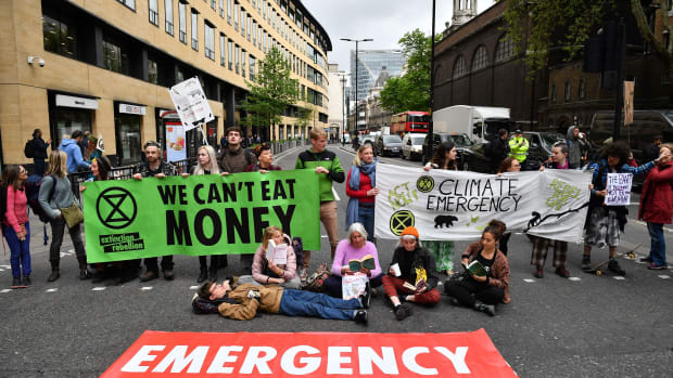 Climate change activists block traffic in the London's financial district during environmental protests by the Extinction Rebellion group in London on April 25th, 2019.
