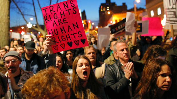 People take part in a rally for trans rights outside the Stonewall Inn in February of 2017.
