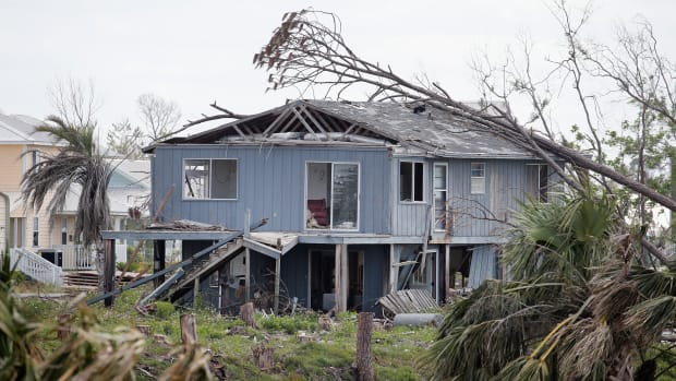 A tree rests on the roof of a home that was heavily damaged by Hurricane Michael on May 9th, 2019, in Mexico Beach, Florida. Seven months after the Category 5 hurricane made landfall near the small community, the town is still littered with damaged and destroyed homes and businesses. According to the Federal Emergency Management Agency, $1.1 billion has been spent on Hurricane Michael-related response and recovery efforts in the state.