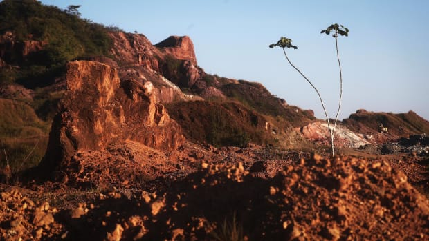 Amazon soil sits in the foreground at the Bom Futuro open air tin mine.