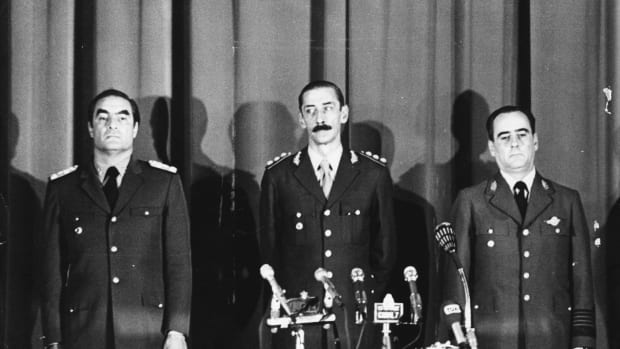 Heads of Argentina's armed forces are sworn in following the coup to overthrow President Maria Estela Peron.