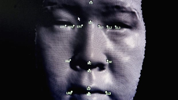 A 3-D facial recognition program is demonstrated during the Biometrics 2004 exhibition and conference.