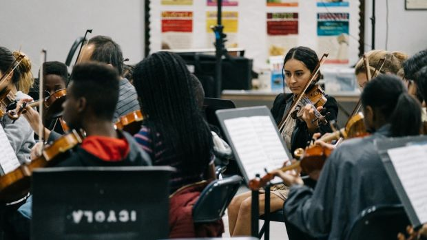 Vianney Bernabé, 24, is a member of the Inner City Youth Orchestra of Los Angeles and assists other students during rehearsals.