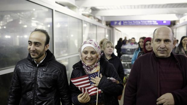 Photo showing a Syrian family walking through O'Hare airport in Chicago