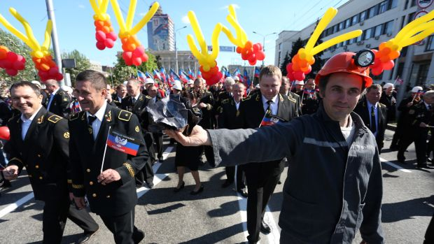 People carry flags and balloons during a rally in Donetsk on May 11th, 2017, to mark the third anniversary of a referendum on the declaration of the Donetsk People's Republic.