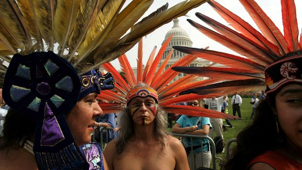A member of an indigenous tribe in Mexico prepares to perform a traditional dance outside the U.S. Capitol with several hundred other protesters on hand to urge Congress to keep the Arctic National Wildlife Refuge off-limits to oil drilling.