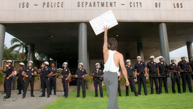 A demonstrator protests the verdict in the trial of four Los Angeles police officers accused of beating motorist Rodney King outside the Los Angeles Police Department headquarters in Los Angeles on April 29th, 1992.