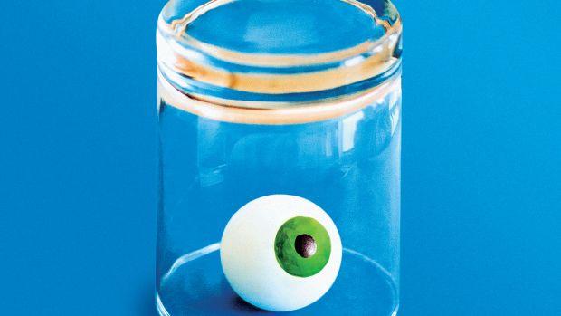An illustration of an eyeball inside an upturned glass.