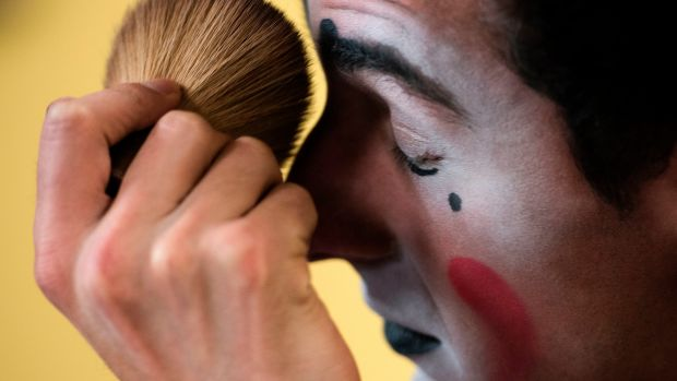 Joe DeSoto, a Ringling Bros. clown, applies powder to make-up between shows on April 14th, 2017 in Fairfax, Virginia.