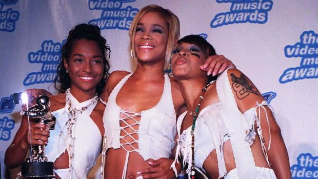 Rozonda 'Chilli' Thomas, Tionne 'T-Boz' Watkins, and Lisa 'Left Eye' Lopes of TLC pose with their award for Best Video of the Year during the 1995 MTV Video Music Awards held at Radio City Music Hall in New York.