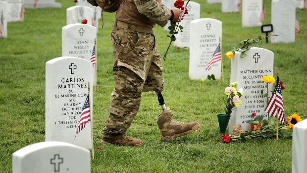 A veteran walks through Arlington National Cemetery in Arlington, Virginia, on May 29th, 2017.