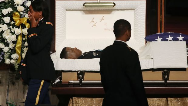 Mourners pay their respects during a funeral service for 2nd Lieutenant Richard Collins III in Upper Marlboro, Maryland, on May 26th, 2017.
