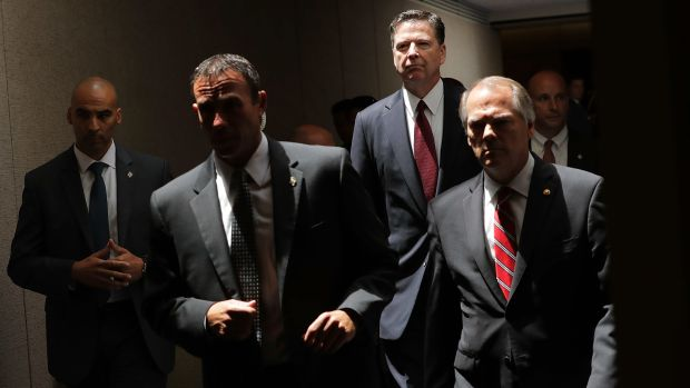 James Comey (second from the right) moves from an open hearing to a closed hearing during a break in testimony before the Senate Intelligence Committee on June 8th, 2017.