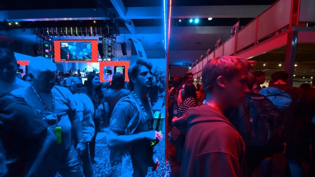 Gaming fans step from the Playstation blue into the Nintendo red display rooms on day one of E3 2017, the three-day Electronic Entertainment Expo, one of the biggest events in the gaming industry calendar, on June 13th, 2017 in Los Angeles, California.